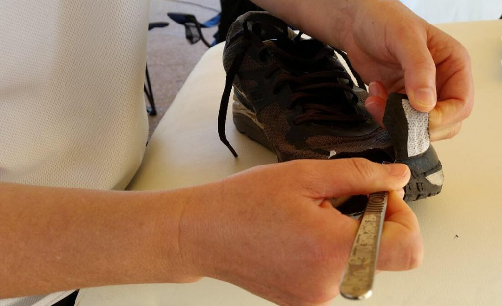 cutting the shoe to give toenail blister relief. This is what can be necessary when pre-race toenail care is neglected
