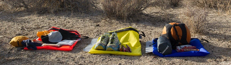 Drop bags carrying dry shoes and socks, among other things to keep your feet dry and prevent maceration