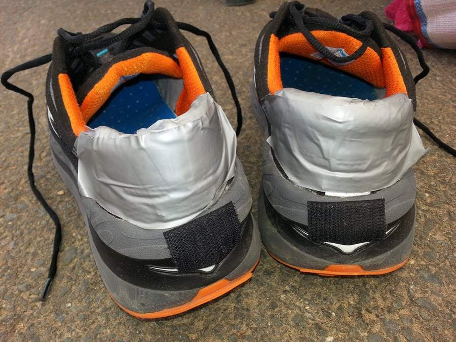 Duct tape to fight holes in the back of running shoes