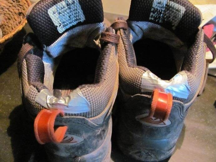 holes in the back of shoes patched with duct tape