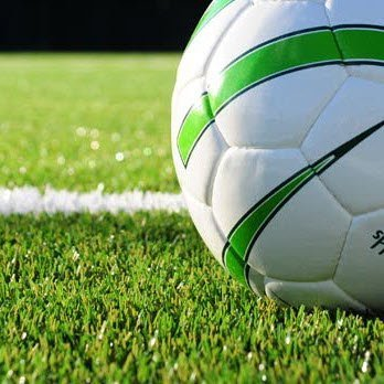 soccer ball and synthetic pitch